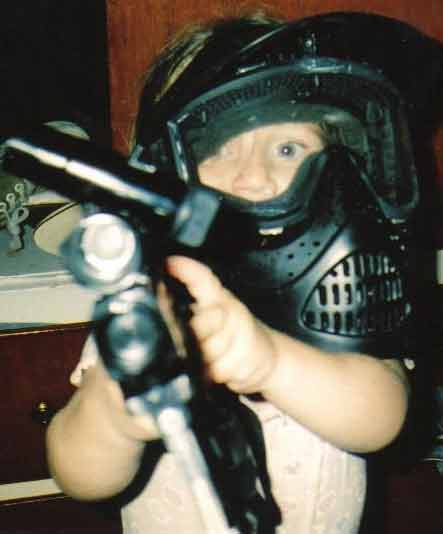 My daughter with paintball gear